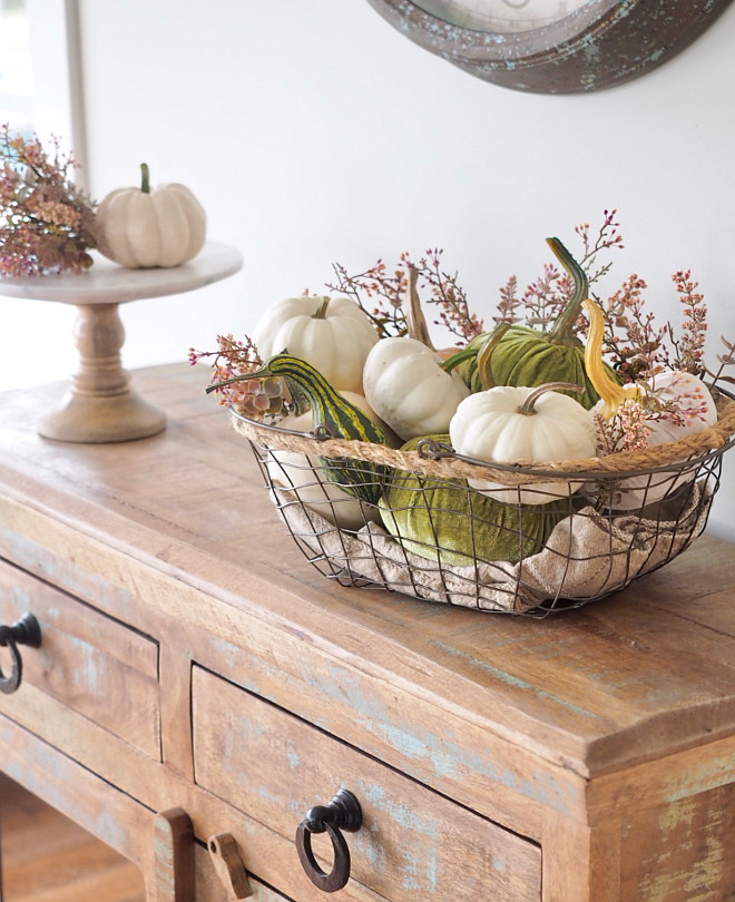Metal basket with faux white pumpkins and velvet pumpkins, squash and greenery. Farmhouse Fall decor #fall #falldecor #farmhousefall #farmhousefalldecor #velvetpumpkins #whitepumpkins #greenery @WowILoveThat