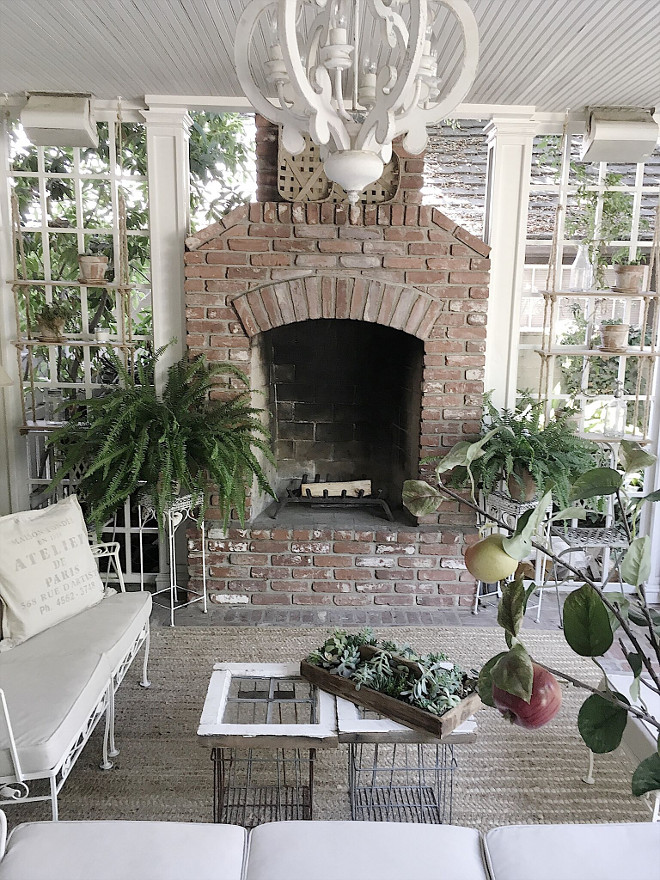 Farmhouse back porch brick fireplace and white and flea market decor. Farmhouse back porch brick fireplace and white and flea market decor. Fixer upper Farmhouse back porch brick fireplace and white and flea market decor #Farmhouse #backporch #brickfireplace #whitedecor #fleamarket #fixerupper Beautiful Homes of Instagram @my100yearoldhome
