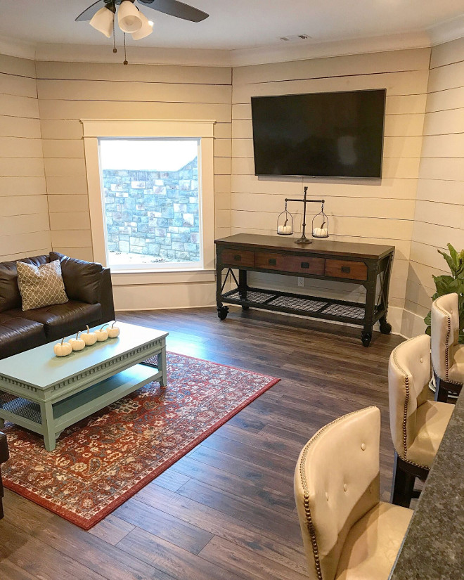 Basement shiplap wall. Basement shiplap wall. Walls are Rough sawn shiplap painted with Sherwin Williams Worldly Gray SW 7043. Basement shiplap wall. Fixer upper Basement shiplap wall. Fixer upper ideas Basement shiplap wall #Fixerupper #fixerupperideas #fixerupperbasement #fixeruppershiplap #Basementshiplap #shiplapwall Home Bunch Beautiful Homes of Instagram @mygeorgiahouse