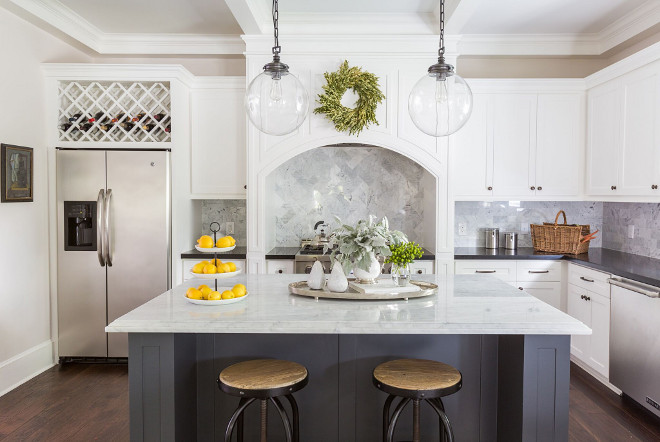 White kitchen with dark grey island, white marble island countertop and black granite perimeter countertop. #kitchen #whitekitchen #darkgreyisland #whitemarble #blackgranite Marie Flanigan Interiors