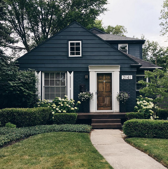 Home Exterior. This small home is a good example that you don't always need to renovate your exterior. Use a trendy yet neutral color like this navy blue, accentuate with thick white trim and give your landscaping some attention. Curb appeal without breaking the bank!