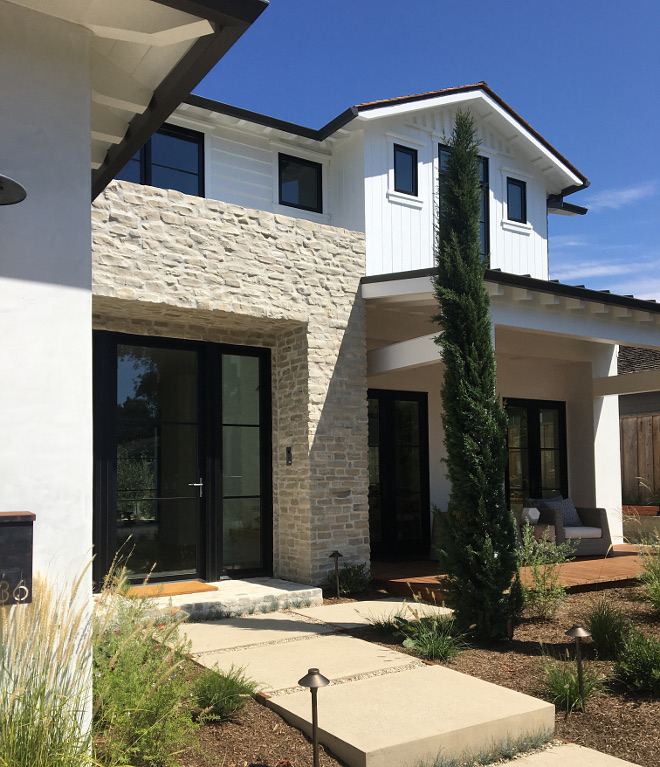 Black Windows Modern Farmhouse exterior with black windows and black steel and glass front door, This stunning steel framed entry and sliding panel door system are La Cantina, Black Windows Modern Farmhouse exterior #BlackWindows #ModernFarmhouseexterior