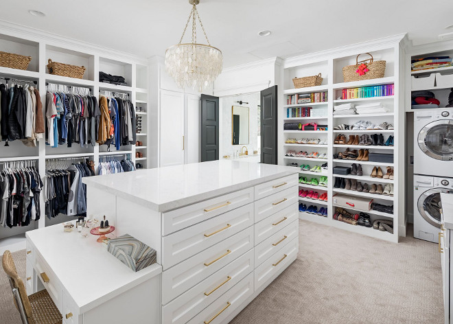 Closet with laundry machine. This spacious walk-in closet features a large island and laundry machines. Walk in Closet with laundry machine. Closet with laundry machine. Closet with laundry machine. Closet with laundry machine #Closetlaundrymachine A Finer Touch Construction