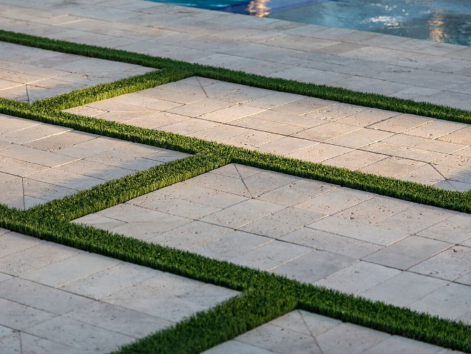 Patio with limestone block and grass. A Finer Touch Construction