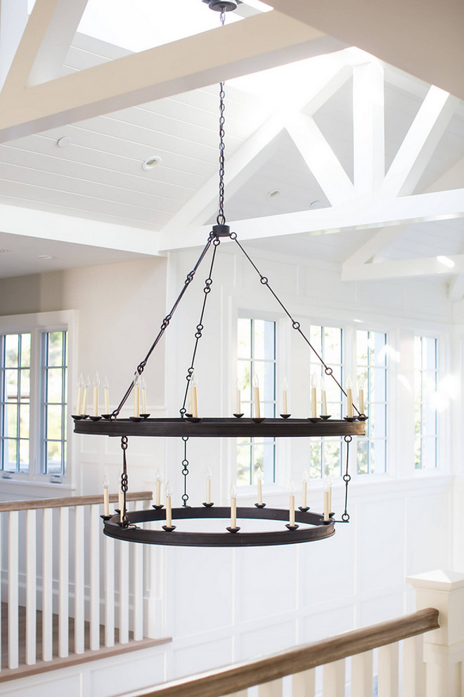 Chandelier Two tiers of flattened iron bands form rings that hang from slender linked chains to make this a powerful 30-light fixture in spaces with high ceilings