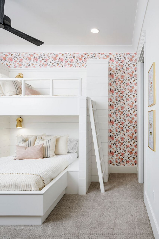 Bunk room. The bunk beds are wrapped in shiplap and then topped off with gold sconces. Each of the sconces can be controlled individually for night time reading. I think we may need to build one at my house next. #bunkroom #bunkbeds #shiplap A Finer Touch Construction