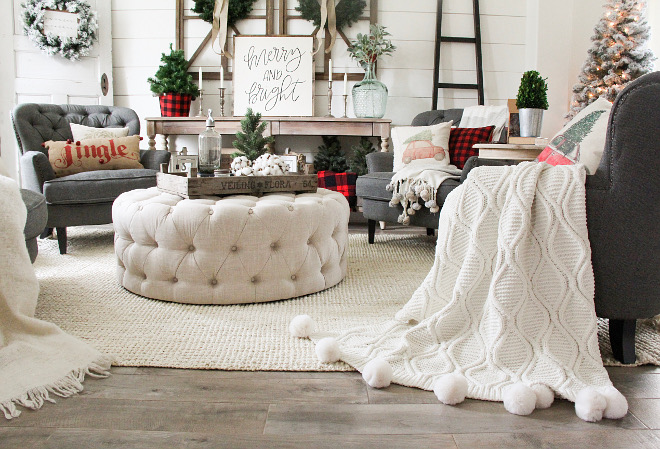 Living room Christmas pillows and pompom throws, round ottoman coffee table and braided rug