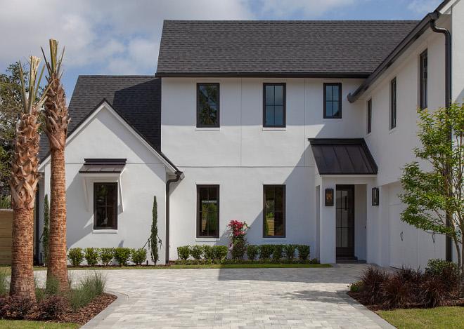Modern Farmhouse with white stucco, black windows and black roof Modern Farmhouse with white stucco, black windows and black roof #ModernFarmhouse #white stucco #blackwindows #blackroof Home Bunch