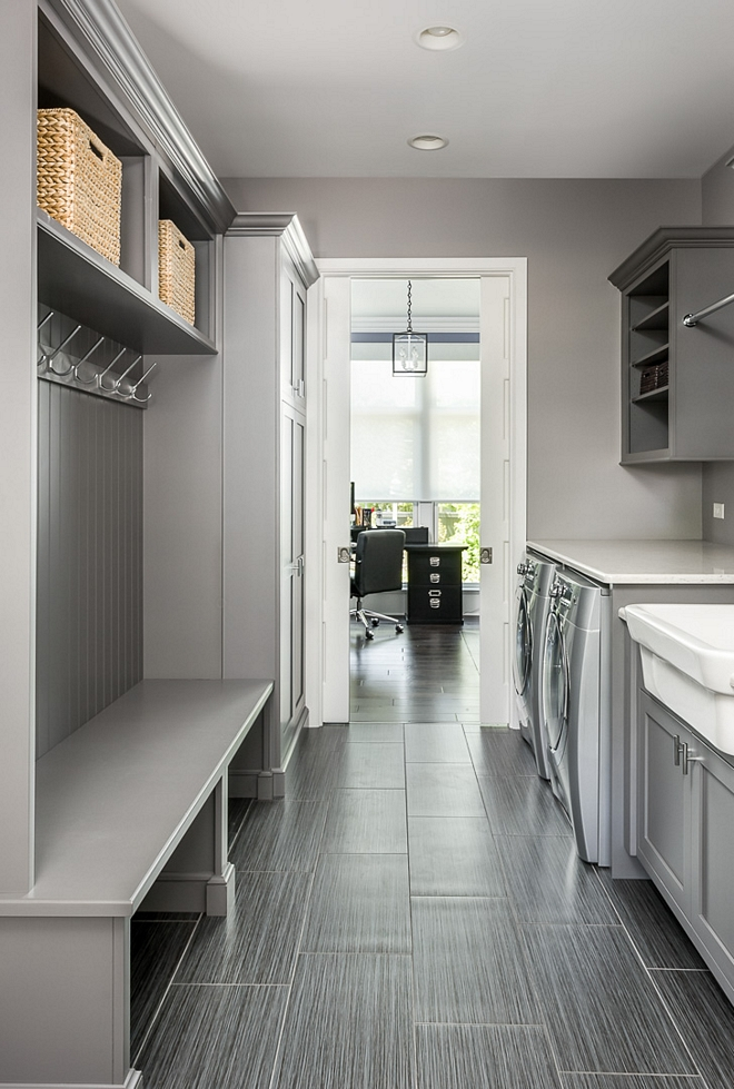 This grey mudroom/laundry room is so practical and the tile is really low-maintenance, which is a must in this space grey mudroom