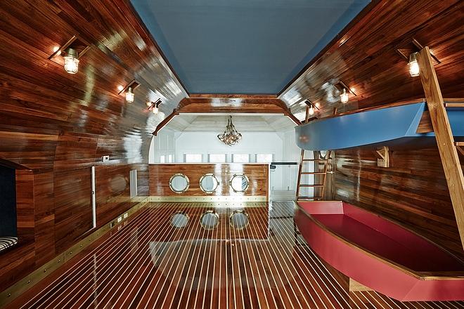 Coastal bunk room with custom boat bunkbeds Coastal bunk room with custom boat bunkbed ideas Coastal bunk room with custom boat bunkbeds design