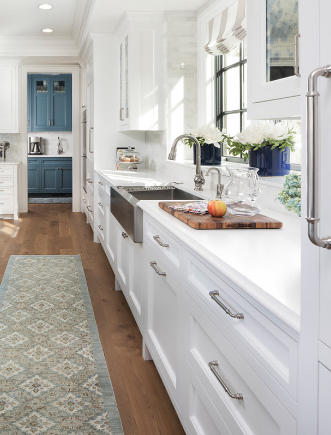 Shaker style kitchen with white quartz countertop and stainless steel farmhouse sink Shaker style kitchen Shaker style kitchen