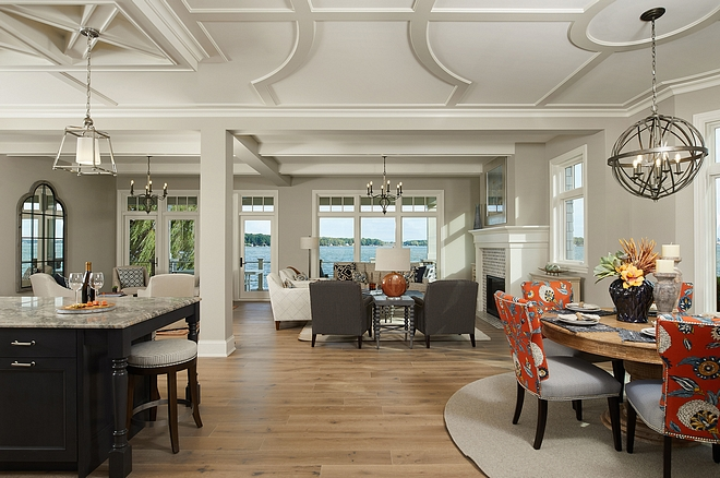 Open floor plan Lakehouse Expansive windows, luxury finishes and a leisurely flowing design plan, optimizes views, sun exposure and circulation between indoor and outdoor spaces #lakehouse #openfloorplan