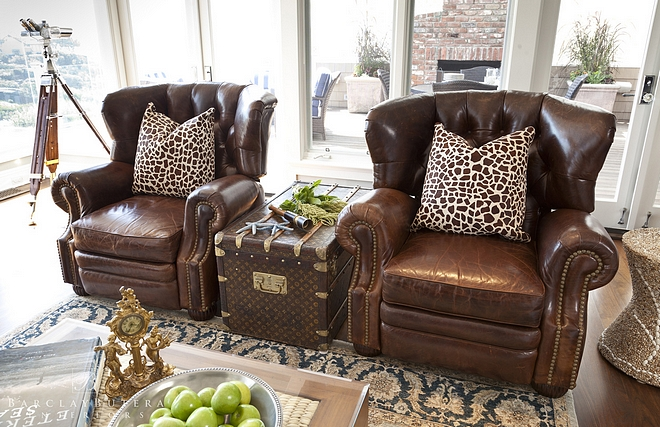 Leather chairs add patina and warmth to any living room These leather chairs look even better with this Louis Vuitton trunk used as a side table
