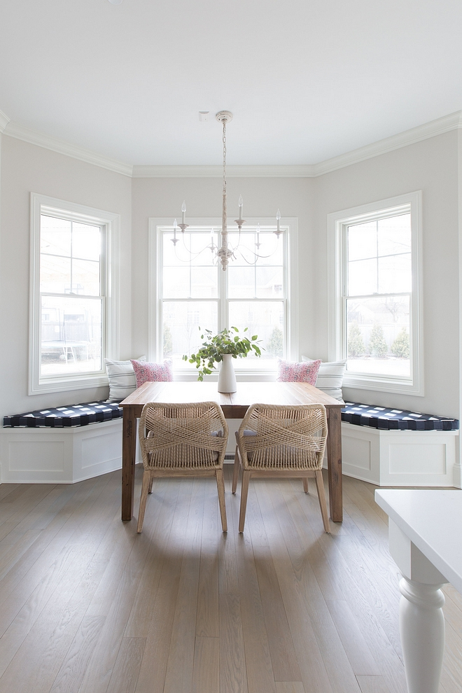 Kitchen nook kitchen nook with builtin banquette with Buffalo Check cushion French chandelier and rope wrapped dining chairs Paint color is Benjamin Moore Classic Gray