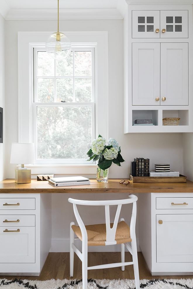 Built in desk with wood countertop and a white Wishbone Chair