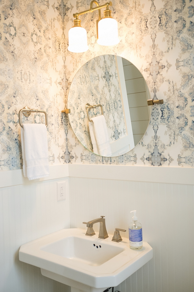 Powder bath with beadboard wainscotting and wallpaper above beadboard wainscoting wallpaper above wainscoting is Anthropologie source on Home Bunch
