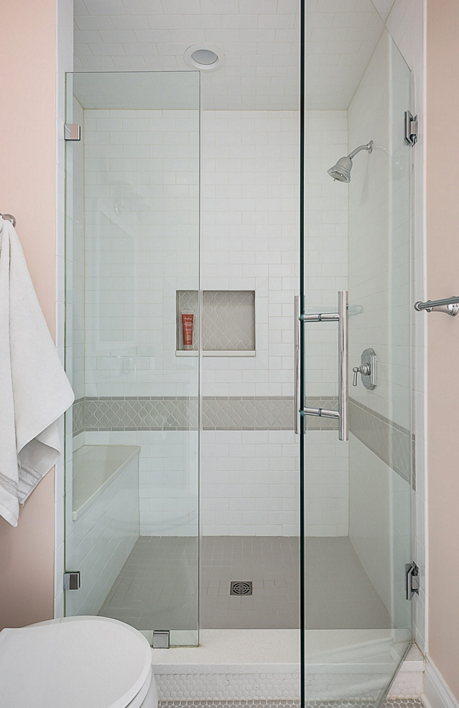 White and grey shower The shower features a classic combination of white and grey tiles Notice the shower bench with quartz slab on the left #showertile
