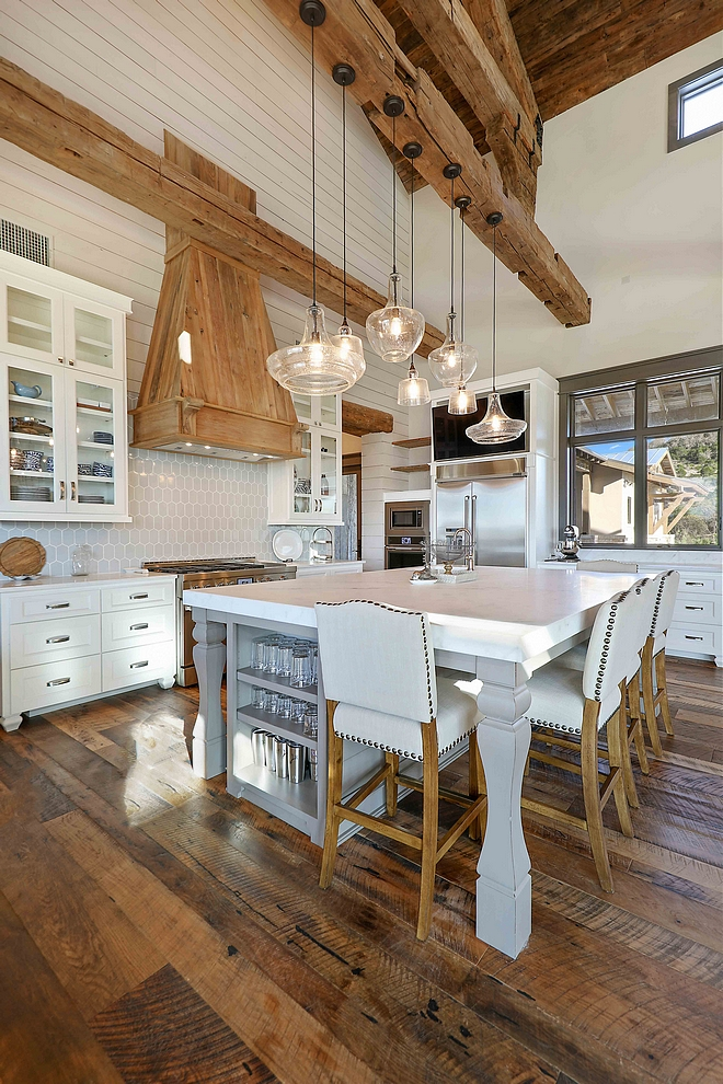 Grey Walker Zanger backsplash tile is blended with reclaimed materials in this rustic farmhouse kitchen elongated hex tile