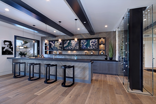 Frameless glass enclosure wine room ideas The two-story frameless glass enclosure wine room continues from the kitchen to the lower level #bar #basement #glassenclosure