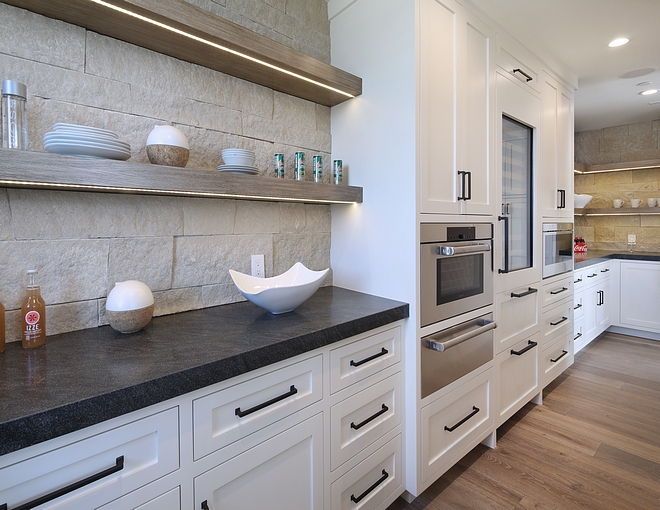 White kitchen paint color Benjamin Moore Cloud CC-40 with Stone backplash Stone is Pewter Veneer and Leathered Black Scozzese Granite countertop