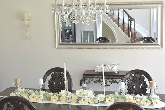 I wanted to keep this room simple so for the tablescape I used some faux florals from Michael's to line the center of the table