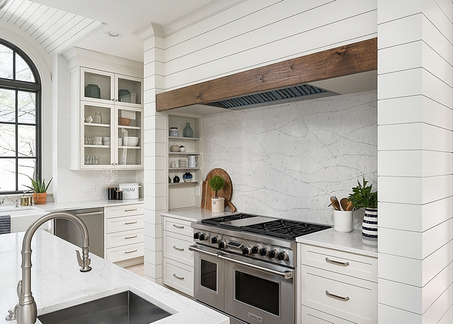 Shiplap Kitchen Shiplap Kitchen Hood Shiplap Hood The custom hood area features shiplap painted in Benjamin Moore White Dove with integrated spice shelves at each end and a custom distressed beam for the mantel #shiplaphood #shiplapkitchen #shiplap #kitchen