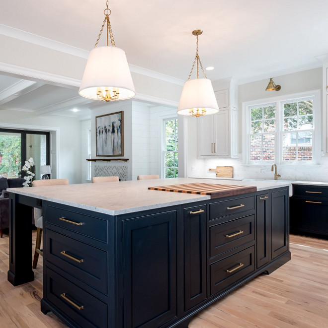 Sooth by Benjamin Moore kitchen island Sooth by Benjamin Moore with honed white marble countertop and large brass pulls #SoothbyBenjaminMoore