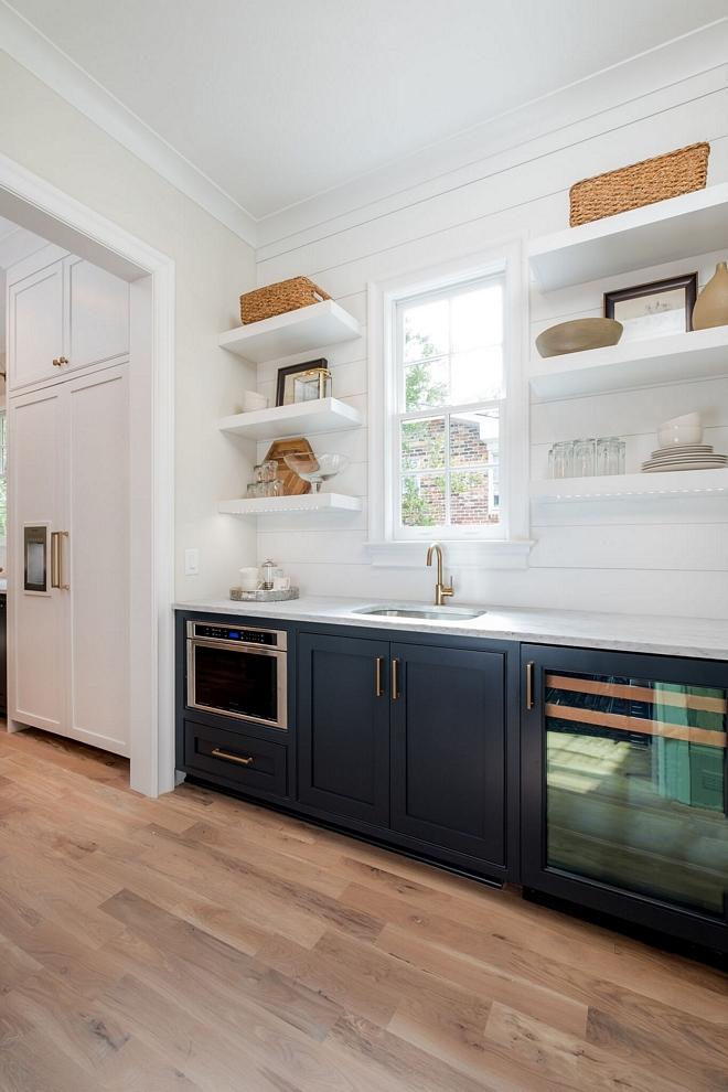 Butlers pantry Stunning butlers pantry Butler's Pantry features the open shelving for displaying fine china pieces, high priced alcohol, and accessories and is backed with shiplap accenting to create visual interest Custom shiplap wall with floating shelves #butlerspantry #shiplap #pantry #shiplapbacksplash #floatingshelves