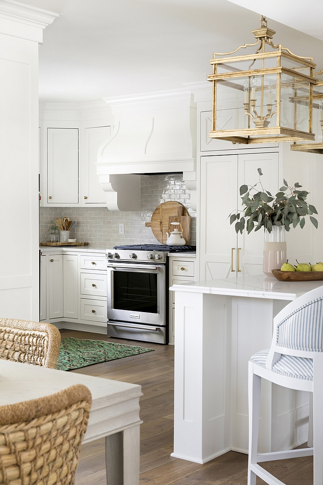 Small Kitchen with off white cabinet paint color Benjamin Moore OC-17 White Dove with hardwood floors brass lighting and marble looking quartz countertop, Calacatta Laza #kitchen #BenjaminMooreOC17WhiteDove #offwhite #smallkitchen