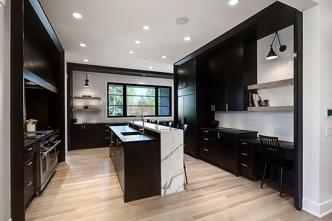 Kitchen with Black cabinets Black kitchen Black and white kitchen This kitchen feels dramatic, modern and unapologetic I love the layout and the raised kitchen island The designer/builder went with a 1/4 sawn white oak for all of the back stained cabinetry #blackkitchen #kitchenlayout #kitchencabinet #blackkitchencabinet #blackcabinet