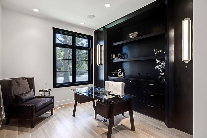 Black and white home office The home office features custom 1⁄4 sawn oak cabinetry Note the floor plug under desk Handy #homeoffice #blackandwhite #office