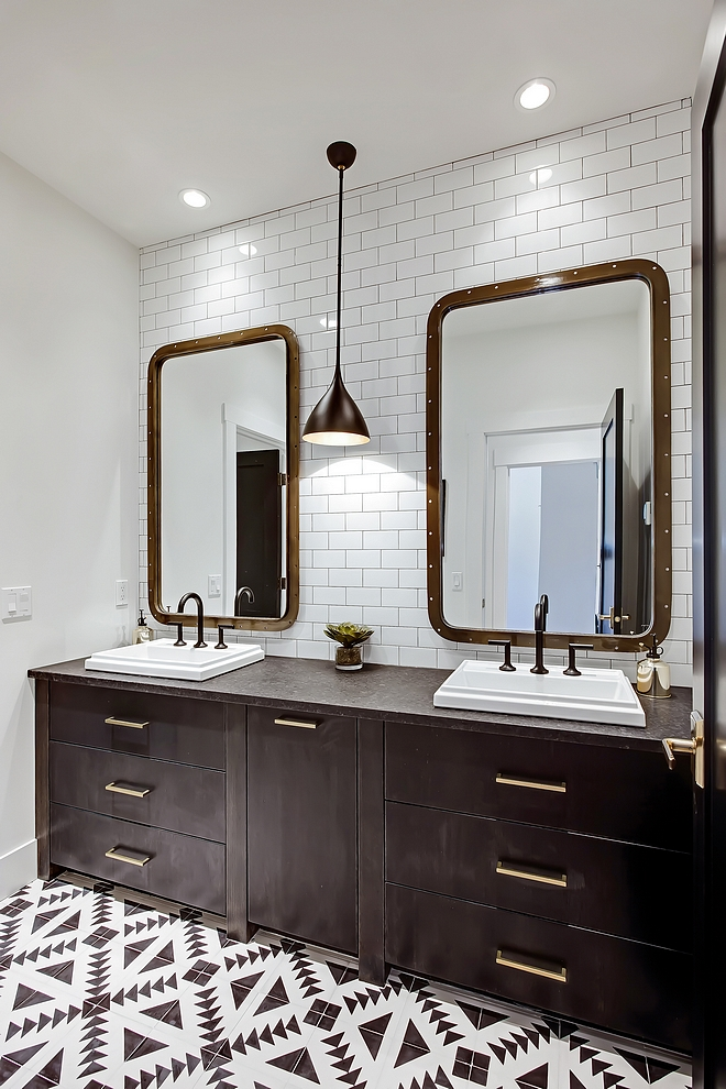 """Bathroom bathroom bathroom features heated 8"""" x 8"""" black and white cement tiles custom vanity, subway tile from counter to ceiling and a pair of industrial mirrors #bathroom"""