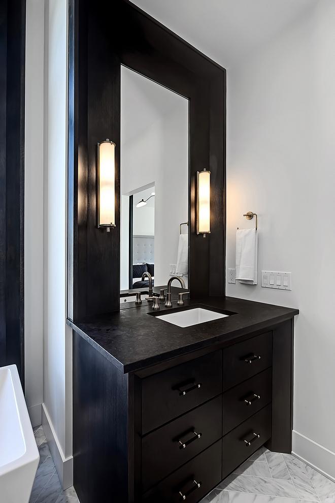 Bathroom features 'His' & 'Hers' custom 1⁄4 sawn oak vanities with granite vanity tops #bathroomvanity