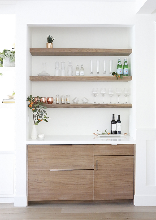 Bar Bar Cabinet The cabinets are custom built with a walnut wood and a glass countertop We used open shelving above in matching walnut wood to display glassware #bar #barcabinet #shelves