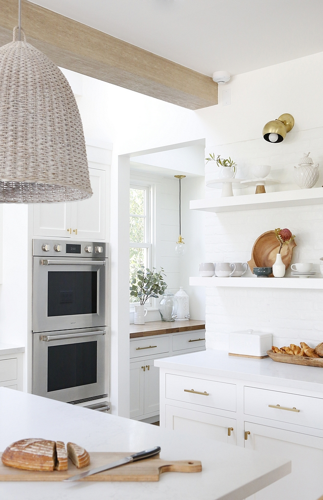 White Quartz Kitchen Countertop Countertops are Calacatta by Caesarstone which have a nice soft marble pattern #WhiteQuartz #KitchenCountertop #Quartzcountertop