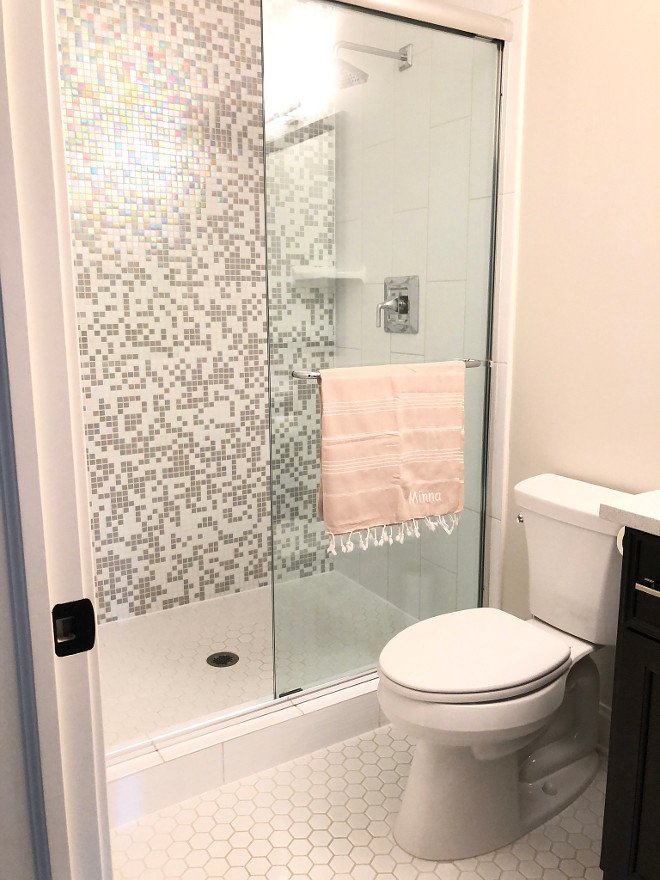 Teen Girl Bathroom Design Teenage bath with iridescent tile Bathroom features white hex floor tile and iridescent shower tile #teenbathroomdesign #iridescenttile