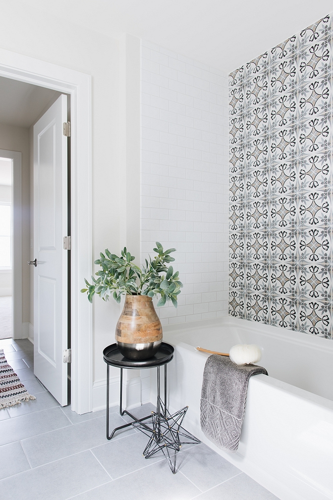 Affordable bathroom renovation ideas Using Encaustic Cement tiles as an accent gives the look of the very expensive bathroom without crushing your budget #bathroomrenovation #affordablerenoideas