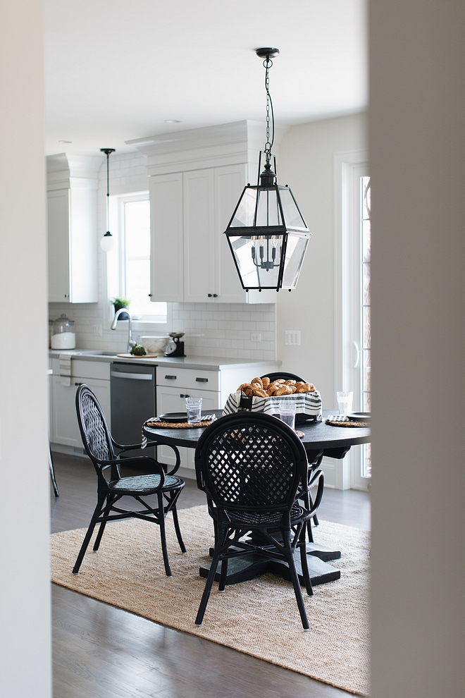 Farmhouse Breakfast Room Farmhouse Breakfast Room with jute rug large black lantern pendant light and black round dining table and black rattan dining chairs from Ikea Farmhouse Breakfast Room Farmhouse Breakfast Room #FarmhouseBreakfastRoom #Farmhouse #BreakfastRoom #lighting #juterug #rounddiningtable #ikeachairs