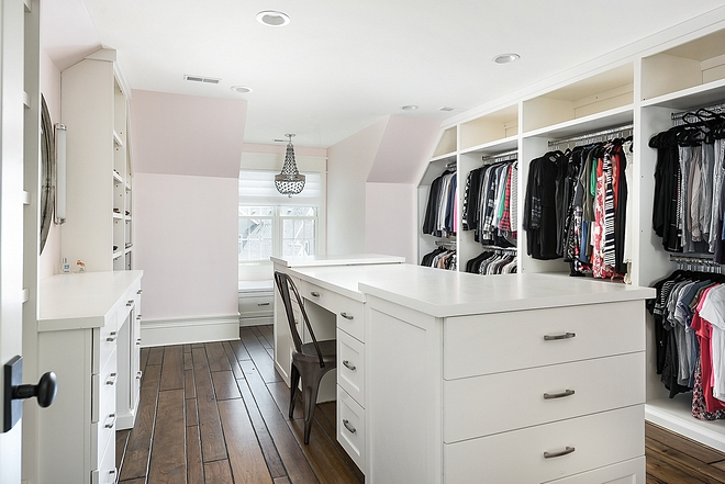 Walk in closet with long island with desk