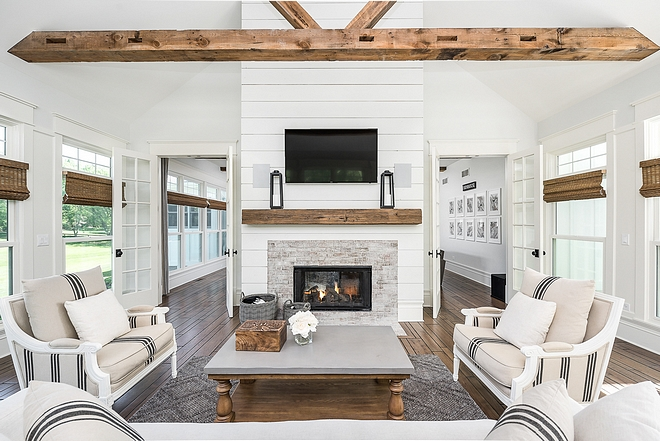 Shiplap fireplace This side of the fireplace features shiplap paneling, whitewashed brick and ceilings feature reclaimed beams Shiplap fireplace Reclaimed Beams Reclaimed Wood Reclaimed Shiplap fireplace #Shiplap #fireplace #reclaimedwood