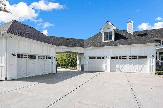 Board and Batten Garage with porte cochere This home features a 3 car attached garage and an additional heated garage/workshop with car lifts Board and Batten Garage Board and Batten Garage Board and Batten Garage #BoardandBattenGarage #BoardandBatten #Garage