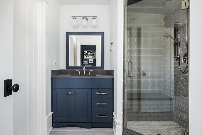 Naval by Sherwin Williams Boys bathroom with navy blue vanity painted in Naval by Sherwin Williams #NavalbySherwinWilliams