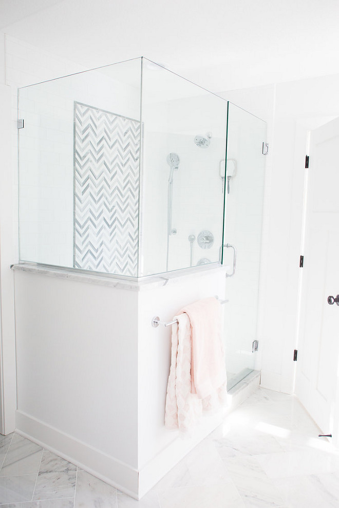 Master Bathroom Shower Ideas shower features white subway tile with a marble chevron accent tile Flooring is white marble tile Master Bathroom Shower Ideas #MasterBathroom #MasterBathroomshower #ShowerIdeas