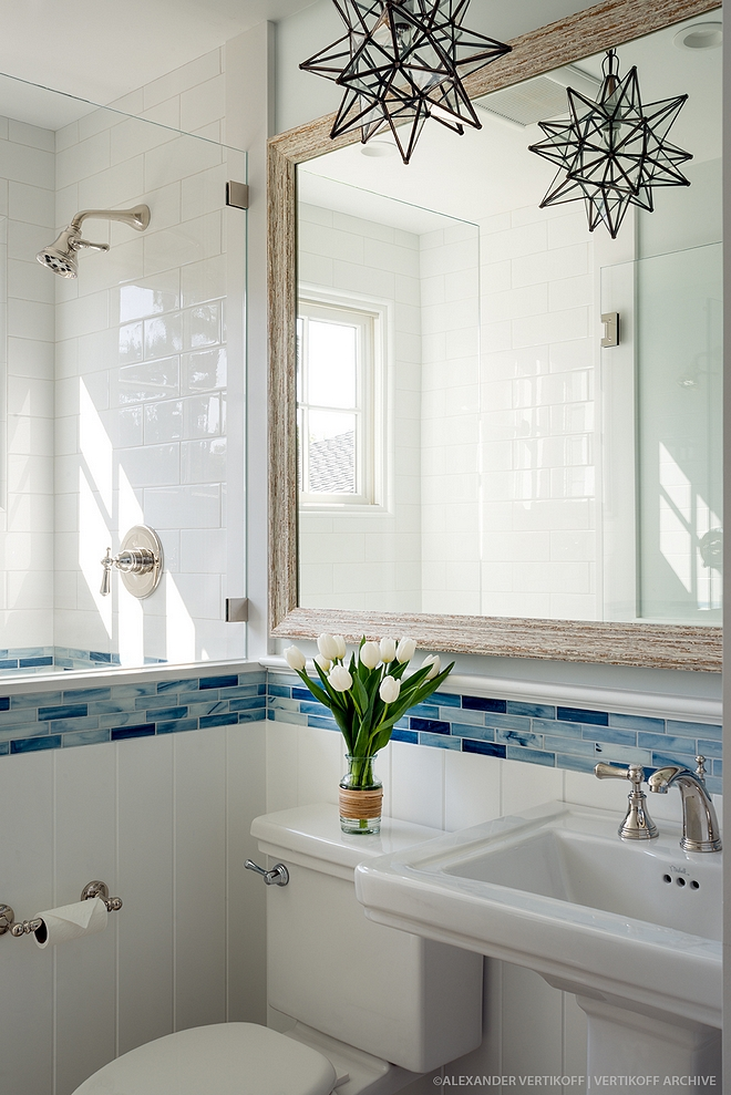 Small Bathroom This shows that a small bathroom can look not only beautiful, but also bright and welcoming The bathroom features a combination of large white subway tile (4x12) and Blue Recycled Glass Accent Tile Small Bathroom Small Bathroom #SmallBathroom #Bathroom #bathroomtile