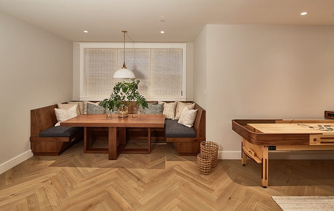 Basement Nook The nook features herringbone flooring, an u-shaped built-in banquette and a custom dining table Basement Nook #Basement #Nook