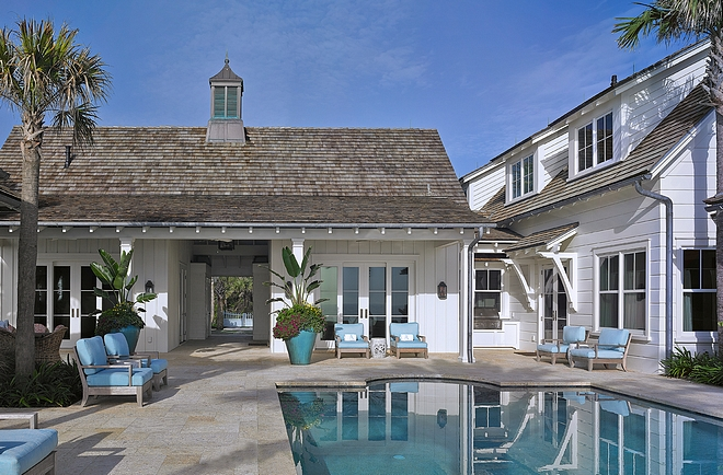 Beach house backyard with pool and poolhouse