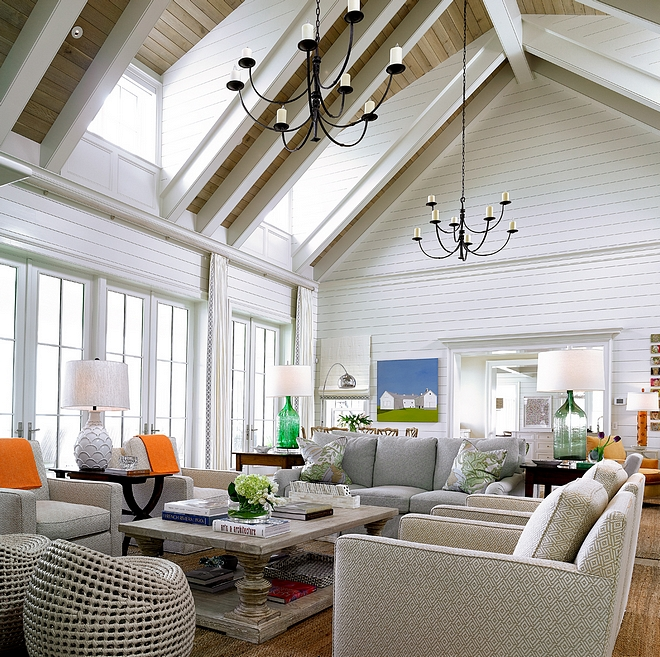 High Ceiling Living room with vaulted ceiling clad in White Oak Shiplap Walls are clad in white shiplap #HighCeiling #Livingroom #vaultedceiling #WhiteOakShiplap #shiplap