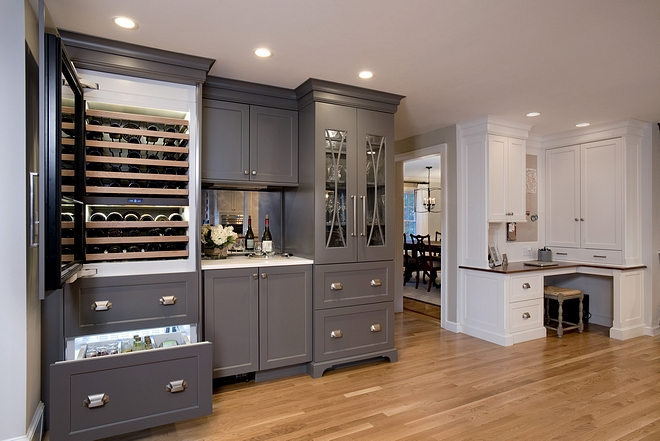 Wine Refrigerator The custom paneled tall wine refrigeration unit was installed at the bar area completing the circle of space for entertaining #WineRefrigerator
