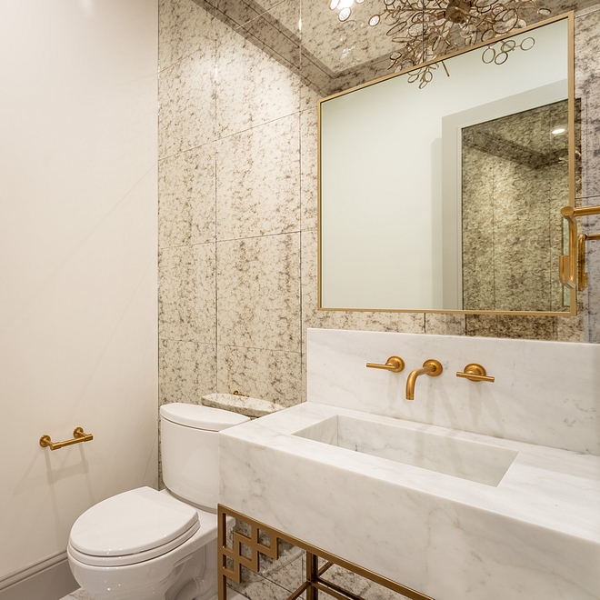 Powder Room The powder room is one of my favorite rooms of the house. You can't help but feel impressed by the glamorous choices found in this space #Powderroom