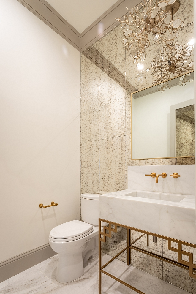 Powder room Glamorous Powder room with Antique Mirror Tile wall tile, brass and marble washstand and brass mirror sources on Home Bunch #Powderoom #AntiqueMirrorTile #MirrorTile